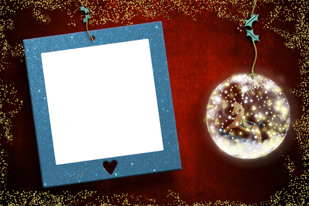 Photo frame Christmas cards, rocking horse old toy inside a christmas buble and empty photo  frame hanging in red wall