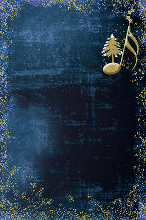 Christmas musical card.  Semiquaver and Christmas tree  golden glitter texture on blue background with copy space. Vertical image.