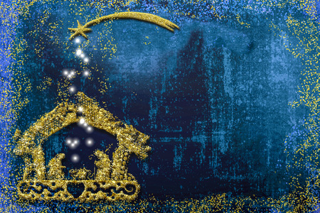 Christmas Nativity Scene greetings cards, abstract freehand drawing of Nativity scene with golden glitter, bue grunge background with copy space. Stock Photo