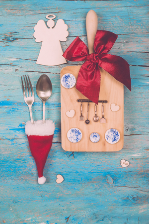 Christmas menu dinner vertical card. Cutting board with vintage  kitchenware and dishes decorated