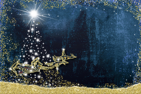 Christmas background  greeting card. Santa Claus sleigh pulled by two geese and stars fir tree, handmade drawing with golden glitter, blue paper background with empty space to write message 写真素材