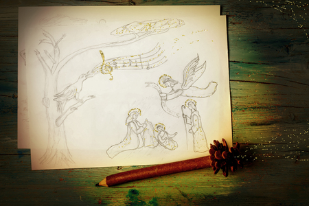 Christmas postcard, Nativity scene, freehand drawing picture with an elf pencil on wooden table