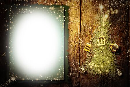 Background invite to write Christmas menu. Old kitchen utensils forming a Christmas tree and paper with copy space on old wooden background.