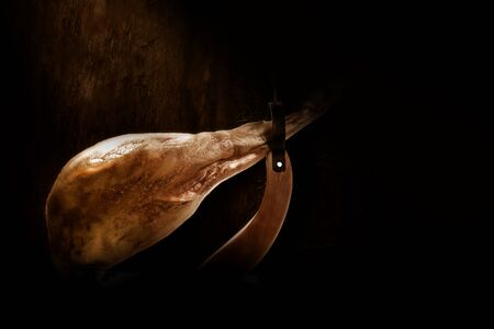 Spanish whole Iberian ham leg extra quality in dark background