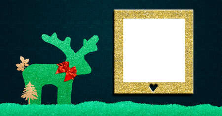 Christmas greetings with photo frame. Fun children's glitter reindeer and gold empty frame. Panoramic format. 免版税图像