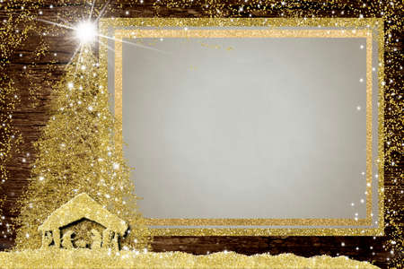 Christmas empty picture frame greetings cards. Nativiy Scene, Christmas and Bethlehem Star golden glitter, empty white picture frame on old wooden background. 免版税图像