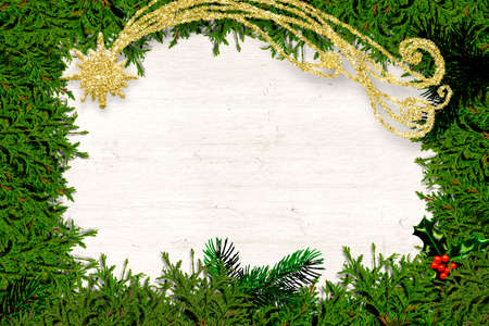 Christmas white background greeting card. Fir branches and holly leaves with gold glitter Bethlehem Star star surrounding white wood with space for text or photos 免版税图像