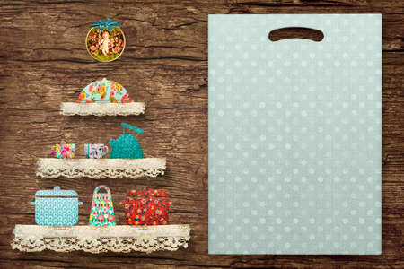 Christmas menu border background. Adorable christmas tree made with fabric cutouts and lace, pots, teapot, saucepan and cutting board to write xmas menu on old wooden wall.
