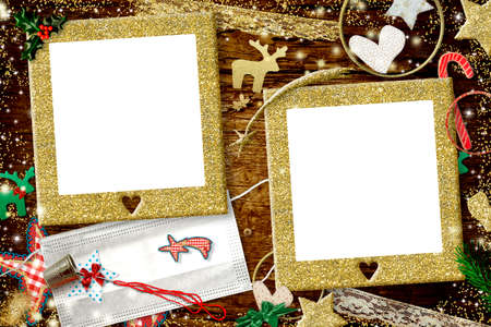 Christmas coronavirus two photo frames card. Christmas with two gold glitter empty photo frames, Christmas ornaments and two masks to customize by hand, diy concept.