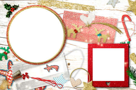 Christmas two empty photo frames greeting card pandemic time. Two empty photo frames, 2 customize face mask for coronavirus protect, xmas ornaments, needle and thimble, craft concept.