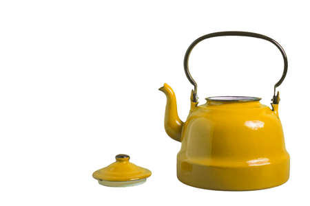 Old yellow porcelain teapot with the lid removed, isolated on white background with blank.