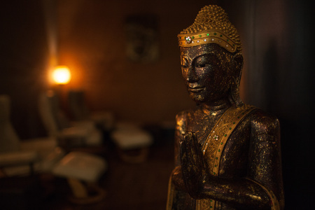 parlor: Buddha statue in a massage parlor Stock Photo