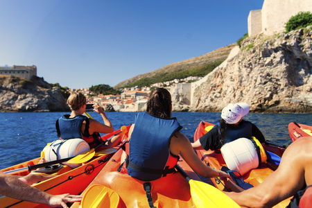 Kayaking among the rocks on the Adriatic Sea in Dubrovnik