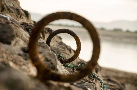 farther: farther rusty metal loop Stock Photo