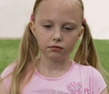 blonde girl crying in the open air portrait photo
