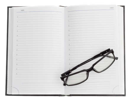 dayplanner: open dayplanner and optical black glasses on the page Stock Photo