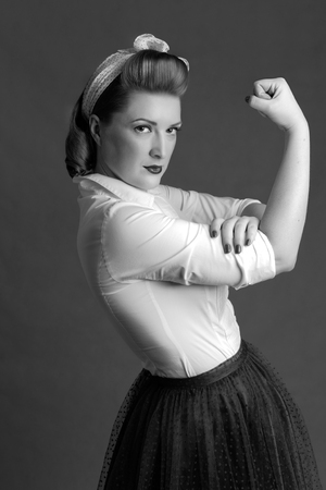 boast: woman blond biceps show-off in retro style