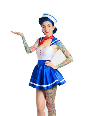pinup girl: Pin-up girl sailor to his full height, hand shows a demonstrative gesture