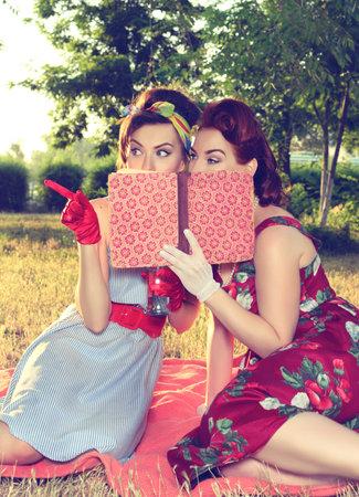 spy girl: two spy girl hiding face behind the book retro