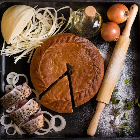 authentic tatar pie on a black sheet with ingredients view from above Stock fotó