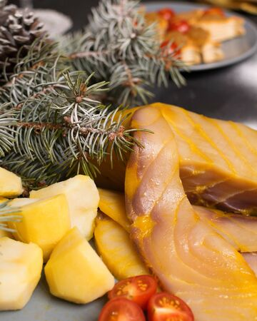 New Years serving, slices of fish and potatoes on a plate Stock fotó