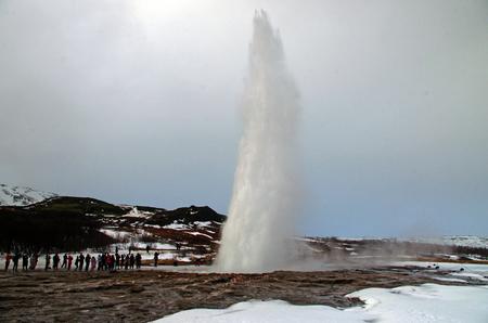 Iceland's winter landscape: Geyser erupting under the snow at Gesir