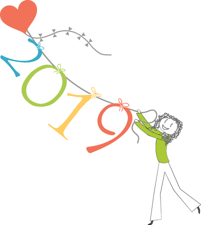A person holds a heart-shaped kite, with the numbers 2019 hanging on it, to celebrate the New Year