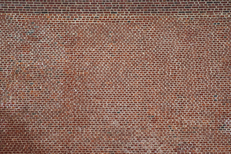 Rustic red brick wall used for house construction Banco de Imagens