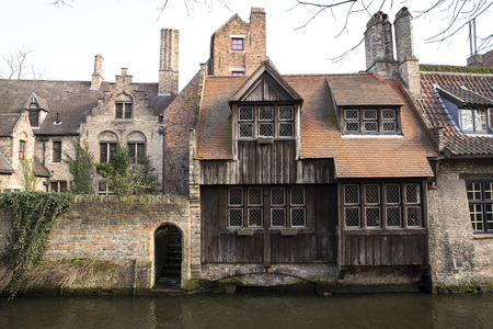 Detail of a typical old house in Bruges, Belgium, on the waterfront