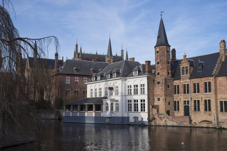 Old typical houses of Bruges in Belgium on the waterfront Banco de Imagens