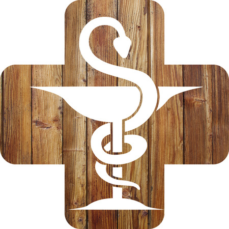 Pharmacy icon on a wooden background Banco de Imagens