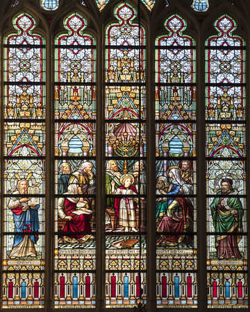 Stained glass window of a church in the historical center of Bruges in Belgium
