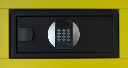 Close-up on an electronic safe with a numeric keypad
