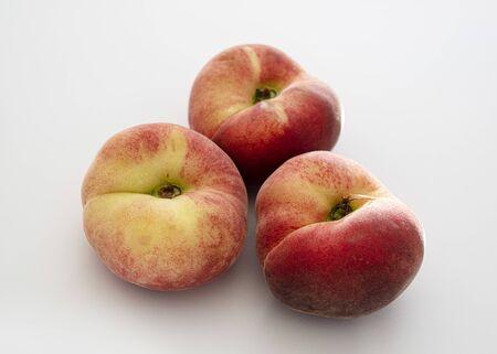 Close-up of ripe peaches on a white background Standard-Bild