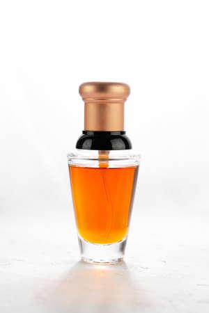 Close-up of an orange perfume bottle