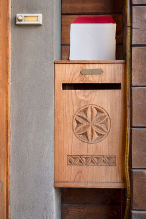 Antique wooden mailbox carved for a house