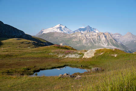 Mountain landscape in summer with a lake and glaciers