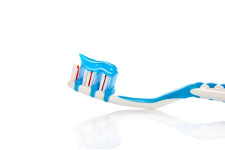 Blue toothbrush isolated on white background  photo
