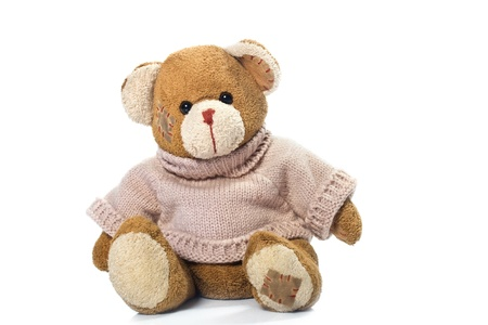 a brown teddy bear with patch on a head sited on white Stock Photo - 9314979