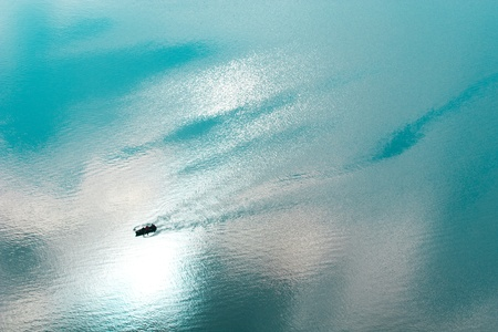Blue sea with boat Stock Photo