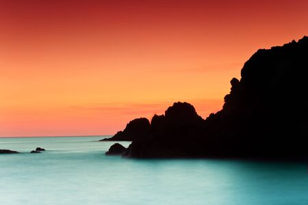 mediterranean sea: Sunset on the coast of the natural park of Cabo de Gata  Stock Photo