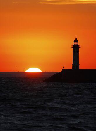 sun down: Lighthouse at sunset