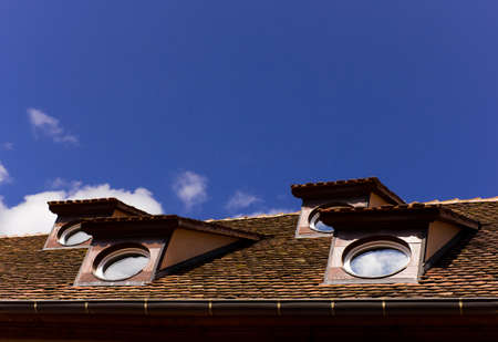 skylights: French roof with oval windows Stock Photo