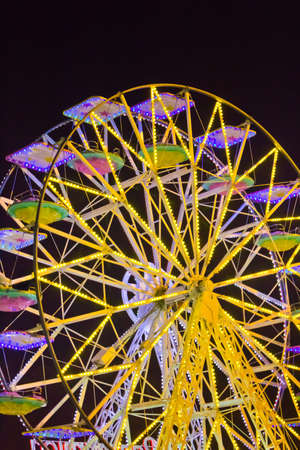 yellow panoramic wheelbright and coloured at the lunapark by night Stock Photo