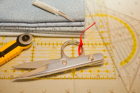 cutter, scissors, square and needles for patchwork photo