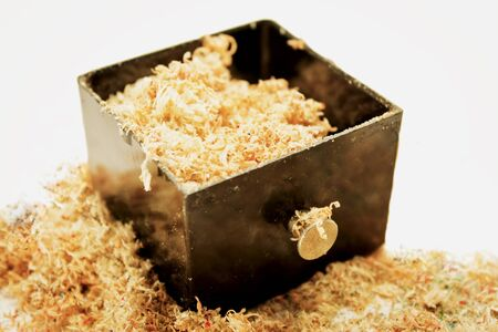 wood shavings: drawer of old 40th black crank sharpener for desk and office with chips