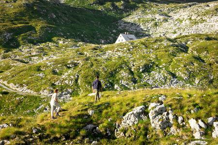 two teenager climbing to refige koca, mount mangart, slovenia