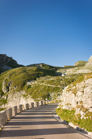 curve in a road towards Mount mangart in slovenia with refuge koca on background Stok Fotoğraf
