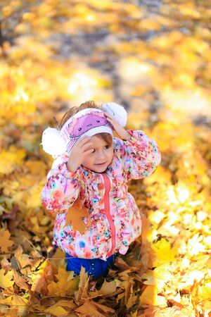 Autumn yellow leaves trees nature nature girl child daughter love exists heat fresh air park bright sunny sitting
