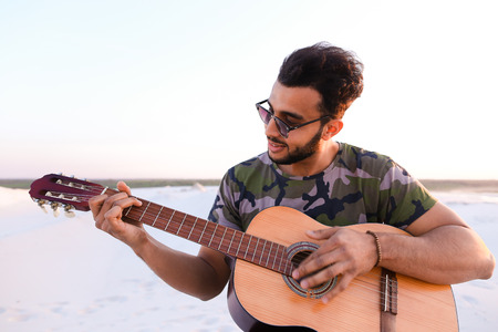 musician performs lyrical melody on musical instrument and guitar